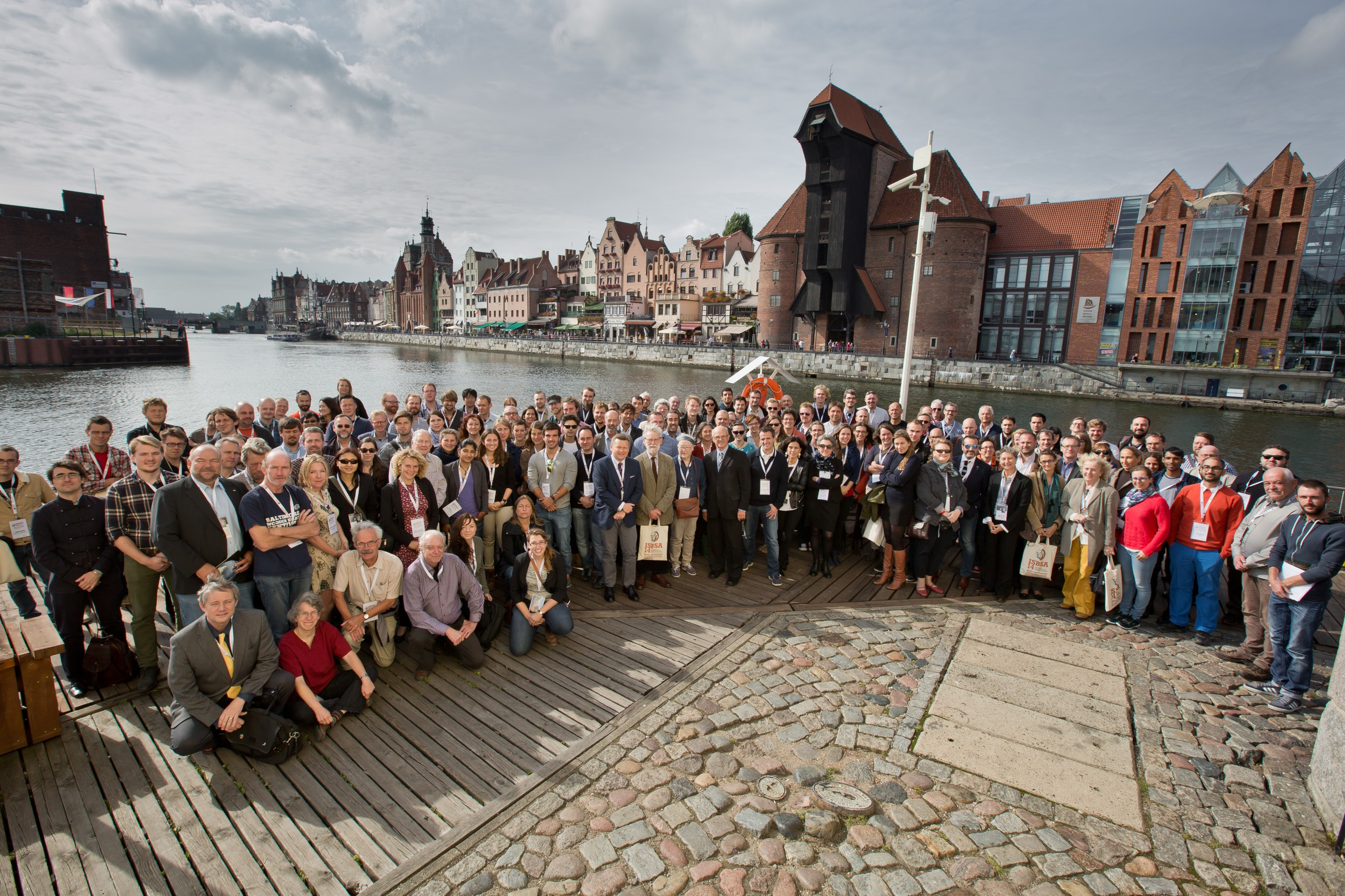 Group photo in front of the medieval crane in Gdańsk made by Paweł Jóźwiak from the National Maritime Museum